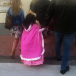 little girl in pink cloak